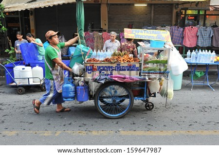 BANGKOK - Apr 12: An unidentified vendor pushes a mobile kitchen on a street in the Khao San area on Apr 12, 2013 in Bangkok, Thailand. There are 16000 registered street vendors in the Thai capital.