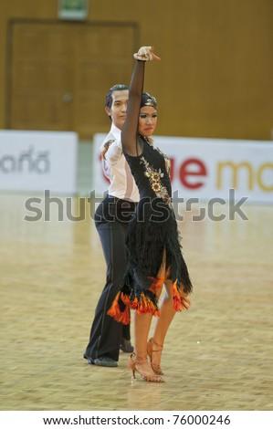 BANGKOK - APR 24 : Unidentified couple dance during TDSA/IDSF Open (Standard & Latin) Dance Sport Championship 2011 on April 24, 2011 in Bangkok, Thailand.