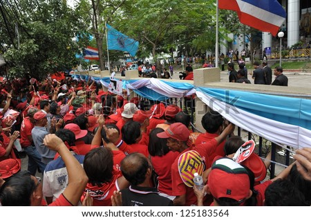 BANGKOK - AUG 9: Red-shirt protesters participate in a rally outside the Criminal Court in opposition to the court meeting to revoke bail of key red-shirt leaders on Aug 9, 2012 in Bangkok, Thailand.