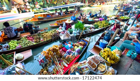 stock photo : Bangkok August 2008. Busy sunday morning at Damnoen Saduak floating market, Bangkok Thailand of locals selling fresh produce, cooked food and souvenirs.