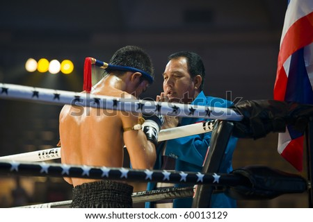 BANGKOK - AUGUST 29: Thaiboxing champion Petchmonkong Petchfocus praying with his coach before a fight in an international competition, on August 29, 2010 in Bangkok, Thailand.