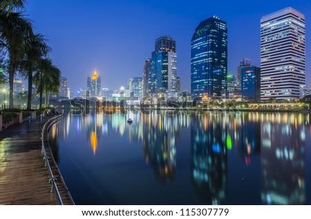 Bangkok city at night with reflection of skyline