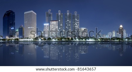 Bangkok city at night with reflection of skyline Bangkok.