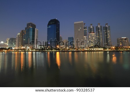 Bangkok city at twilight time with reflection from skyline and building
