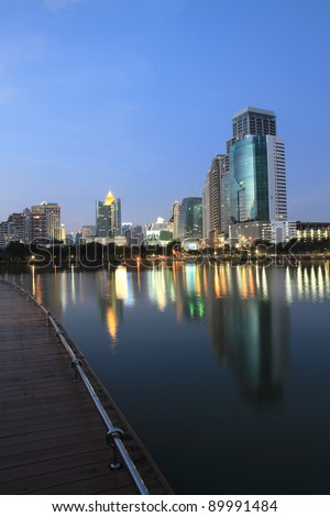 Bangkok city at twilight time with reflection of skyline and building