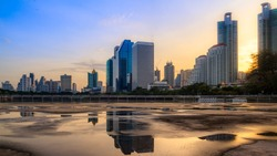 Bangkok city sunrise reflection river of sun. Panoramic view light blue background of glass high rise building skyscraper commercial of future. Business concept of success industry tech architecture