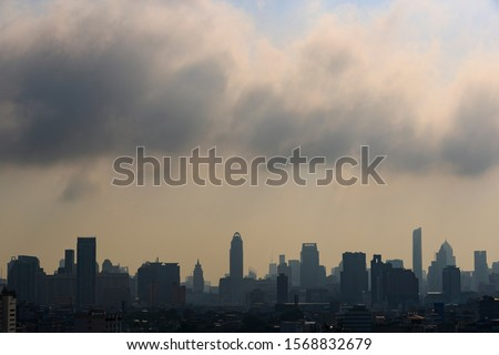 Bangkok city, the capital of Thailand, and building are covered by heavy smog, air pollution under heavy cloud, misty morning in the city, silhouette cityscape of Bangkok.