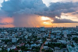 Bangkok city twilight view in Ari District Area, Rainy season in Bangkok, Rain is coming in twilight time, Rainy cloud against twilight sunset,