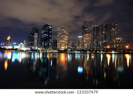Bangkok cityscape at night with  skyline reflection,Thailand
