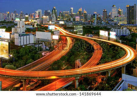Bangkok cityscape. Traffic on the freeway in the business district. at dusk.