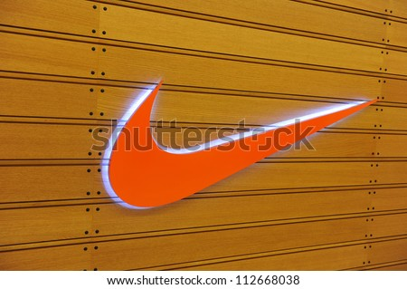 BANGKOK - DEC 27: Exterior of a sporting goods store displaying the Nike Swoosh logo on Dec 27, 2011 in Bangkok, Thailand. Forbes values Nike at $10.7B, making it the most valuable sports brand.