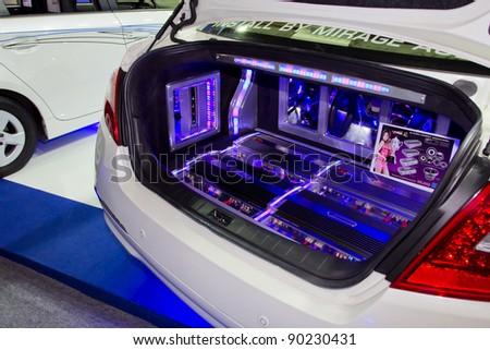 BANGKOK - DECEMBER 4: Car Audio Show Installation in Nissan Teana car audio booth at the 28th Thailand International Motor Expo on December 4, 2011 in Bangkok, Thailand.