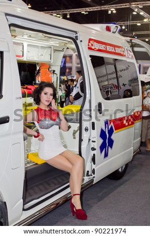 BANGKOK - DECEMBER 4: Female presenters model at the Emergency medical services car booth on display at the 28th Thailand International Motor Expo on December 4, 2011 in Bangkok, Thailand.