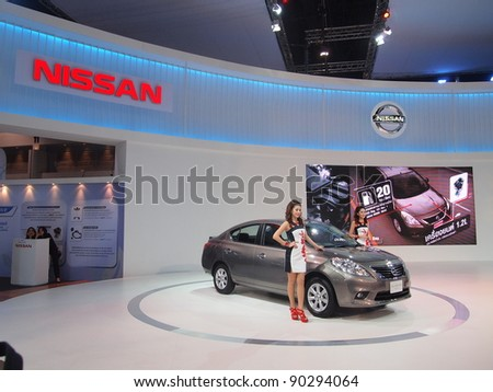 BANGKOK - DECEMBER 6: Female presenters model at the nissan   corporation booth at the 28th Thailand International Motor Expo on December 6, 2011 in Bangkok, Thailand.