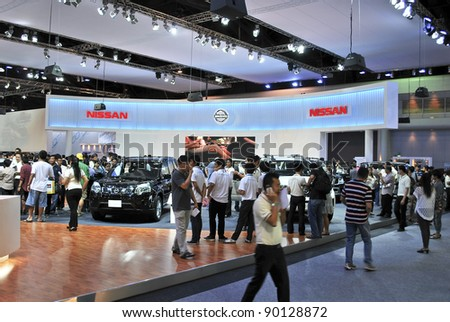 BANGKOK - DECEMBER 3: Nissan's booth with crowded people at Motor Expo, Impact on December 3, 2011 in Bangkok, Thailand.