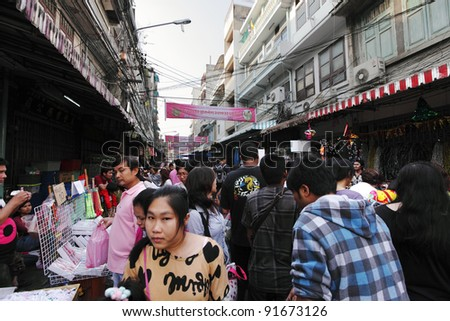 BANGKOK - DECEMBER 25: Shoppers in the crowded street bazaar on December 25, 2011 in Bangkok Chinatown, Yaowaraj Rd, Bangkok. Bangkok return to normalcy after the worst flood in 20 years.