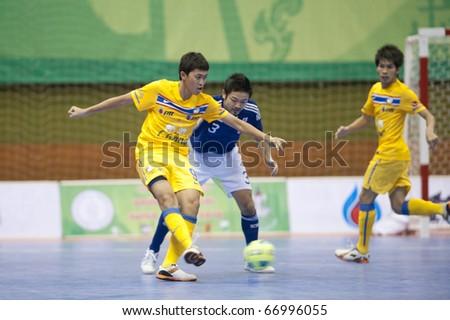 BANGKOK - DECEMBER 11 : Thailand vs Japan, Bangkok Futsal Super Match 2010,Suphawut Tompa (L) and Wataru Kitahara(R) on DECEMBER 11 -12, 2010 in Bangkok Thailand.