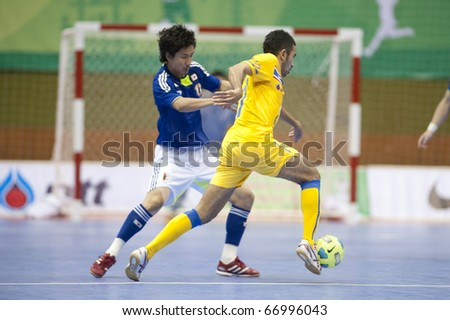 BANGKOK - DECEMBER 11 : Thailand vs Japan, Bangkok Futsal Super Match 2010,Suphawut Tompa (R) and Mitsuyoshi Matsumiya (L) on DECEMBER 11 -12, 2010 in Bangkok Thailand.