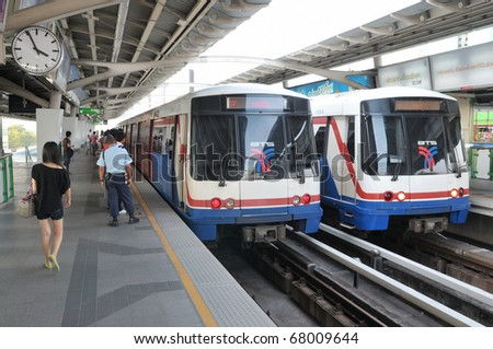 BANGKOK - DECEMBER 19: Two BTS Skytrains at a station on Sukumwit Road on December 19, 2010 in Bangkok, Thailand. The rail network recently marked its 10th year of operations in the Thai capital.