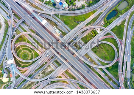Bangkok Expressway top view, Top view over the highway,expressway and motorway at night, Aerial view interchange of a city, Shot from drone, Expressway is an important infrastructure in Thailand.