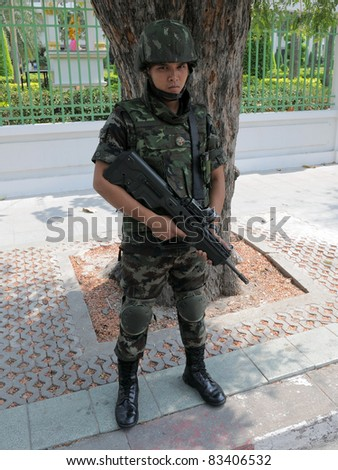 BANGKOK - FEB 11: A soldier on guard near government buildings as anti-government yellow-shirts leaders indicate their intention to occupy Government House on Feb 11, 2011 in Bangkok, Thailand.
