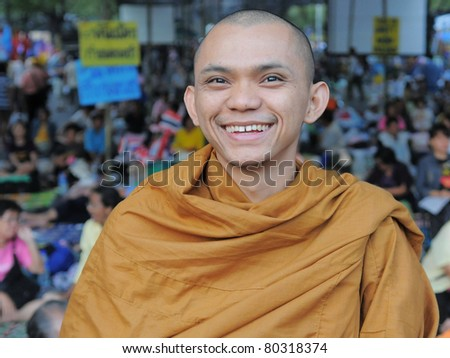 BANGKOK - FEB 8: An unidentified Buddhist monk attends a large yellow-shirt rally outside Government House Feb 8, 2011 in Bangkok, Thailand.