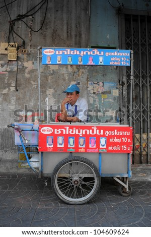 BANGKOK - FEB 3: An unidentified iced drink street vendor waits for customers in Bangkok's Chinatown Feb 3, 2011 in Bangkok, Thailand. There are more than 16,000 registered street vendors in Bangkok.