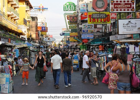 BANGKOK - FEB 25: Tourists walk along backpacker haven Kaosan Road as officials warn visas on arrival may be rolled back in the wake of recent terrorism incidents on Feb 25, 2012 in Bangkok, Thailand.