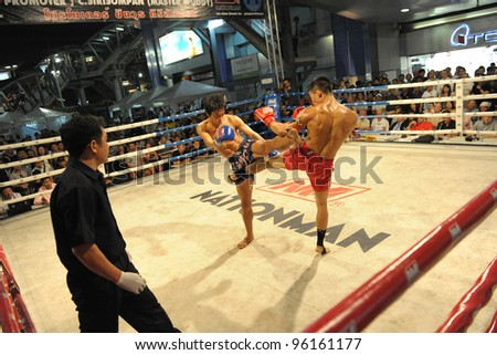 BANGKOK - FEB 22: Unidentified Muay Thai fighters compete in a Thai kickboxing match at MBK Fight Night on Feb 22, 2012 in Bangkok, Thailand.