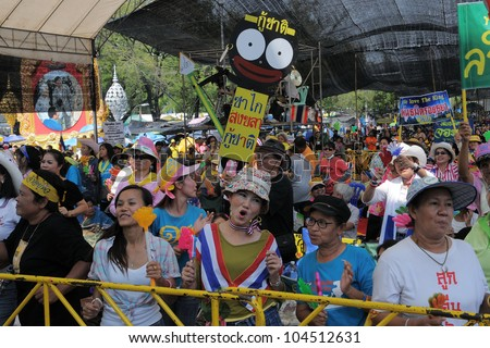 BANGKOK - FEB 11: Unidentified nationalist People's Alliance for Democracy, or yellow-shirts, protesters attend an anti-government rally outside Government House on Feb 11, 2011 in Bangkok, Thailand.