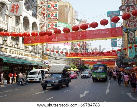 BANGKOK - FEBRUARY 14: Red lanterns and decorations span Yaowarat Road in Bangkok's Chinatown district during the Chinese New Year celebrations on February 14, 2010 in Bangkok, Thailand.