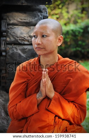 BANGKOK - JAN 25: A Buddhist monk prays while attending a pilgrimage through the Thai capital on Jan 25, 2013 in Bangkok, Thailand. 1,128 monks have joined the pilgrimage of over 26 days and 446 km.