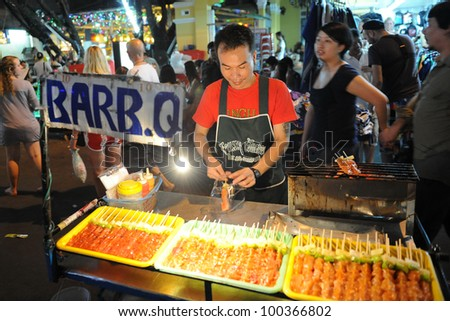 BANGKOK - JAN 15: An unidentified street vendor prepares food on Khao San Road on Jan 15, 2012 in Bangkok, Thailand. There are 16,000 registered street vendors in Bangkok according to the government.