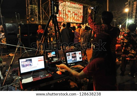 BANGKOK - JAN 29: An unidentified video editor operates an editing system during a large red-shirt rally on the Royal Plaza on Jan 29, 2013 in Bangkok, Thailand.