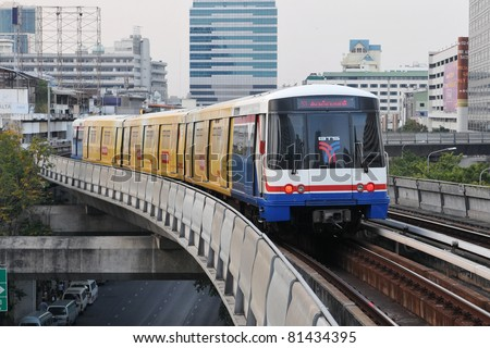 BANGKOK - JAN 13: BTS Skytrain speeds through the city center Jan 13, 2011 in Bangkok, Thailand. The mass transit rail network recently marked its 10th year of service in the Thai capital.