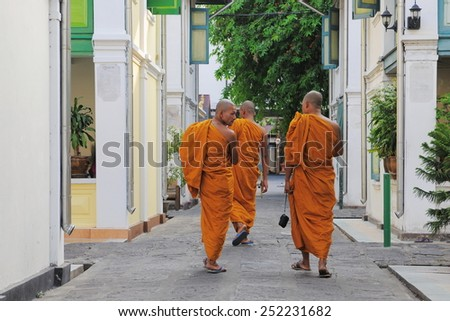 BANGKOK - JAN 20: Buddhist monks walk through the grounds of a city centre temple on Jan 20, 2011 in Bangkok, Thailand. There are an estimated 460,000 ordained monks in the Kingdom of Thailand.