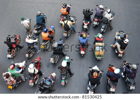 BANGKOK - JAN 13: Motorcyclists wait at a junction  during rush hour on Jan 13, 2011 in Bangkok, Thailand. Motorcycles are often the transport of choice for Bangkok's heavily congested roads.