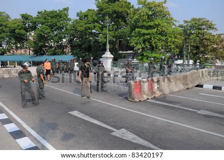 BANGKOK - JAN 25: Police Commandos guard a barricade on Makkhawan Bridge outside Government House on Jan 25, 2011 in Bangkok, Thailand. Bangkok continues to see street protests and bomb alerts.