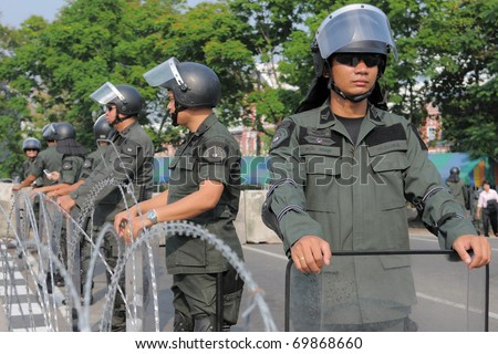 BANGKOK - JAN 25: Police Commandos guard a barricade on Makkhawan Bridge outside Government HQ on Jan 25, 2011 in Bangkok, Thailand. The Thai capital continues to see street protests and bomb alerts.