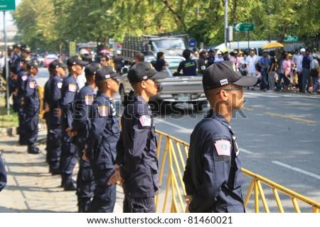 BANGKOK - JAN 25: Police Commandos guard a barricade on Makkhawan Bridge outside Government HQ on Jan 25, 2011 in Bangkok, Thailand. The Thai capital continues to see street protests and bomb alerts.