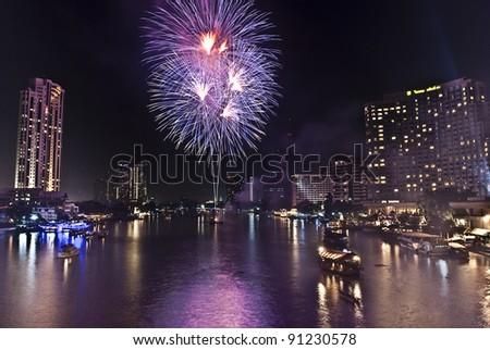 BANGKOK-JAN 01:The happy new year 2011 exploding fireworks over chaophraya river in bangkok Thailand on January 1,2011 in Bangkok - stock photo