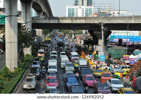 BANGKOK - JAN 25: Traffic nears gridlock on a busy road in the city centre on Jan 25, 2013 in Bangkok, Thailand. Annually an estimated 150,000 new cars join the heavily congested roads of Bangkok.