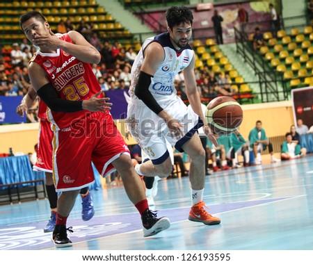 """BANGKOK JAN25:Wutipong Dawson #73 participates in an ASEAN Basketball League """"ABL"""" at Nimitbut Stadium on January 25, 2013 in Bangkok,Thailand.CTS beat JSS 65-62"""