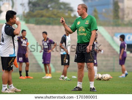 BANGKOK - JANUARY 6: Matt Elliott (green) head coach of Army United and former Leicester City footballer in action during the training session at Army Stadium on January 6, 2014 in Bangkok, Thailand.
