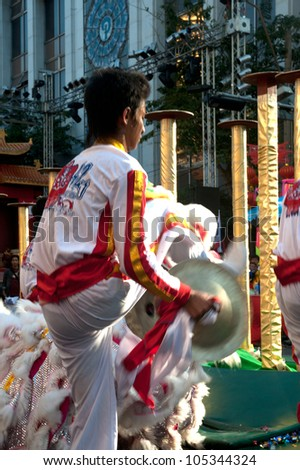BANGKOK--JANUARY 20: Unidentified performer provide music for the traditional Lion Dance outside the Temple during Chinese New Year celebrations on January 20, 2012 in Bangkok,Thailand.