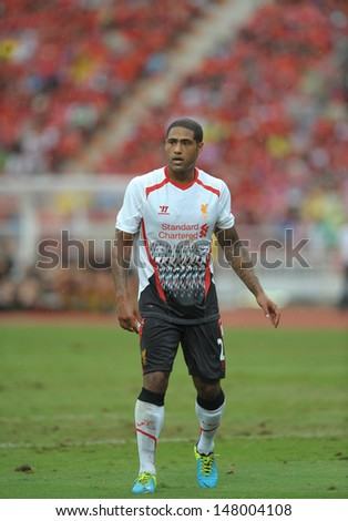 BANGKOK,JULY 28 : Glen Johnson of Liverpool FC in action during Liverpool FC Tour 2013 Thailand between Thailand (R) and Liverpool (W) at Rajamangala Stadium on July 28, 2013 in Bangkok, Thailand. - stock photo