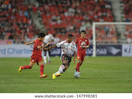 BANGKOK - JULY 28 : Jordon Ibe (W) of Liverpool in action during Liverpool FC Tour 2013 Thailand, Liverpool FC (W) vs Thailand (R) at Rajamangala Stadium on July 28 ,2013 in Bangkok, Thailand.