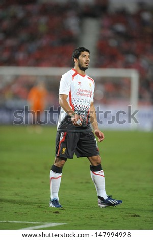 BANGKOK - JULY 28 : Luis Suarez (W) of Liverpool in action during Liverpool FC Tour 2013 Thailand, Liverpool FC (W) vs Thailand (R) at Rajamangala Stadium on July 28 ,2013 in Bangkok, Thailand.