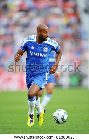 BANGKOK - JULY 24 : N.Anelka in action during Coke Super Cup :Chelsea Asia Tour 2011 Thailand. TPL All Star between Chelsea at Rajamangla Stadium ,July 24, 2011 in Bangkok, Thailand. - stock photo