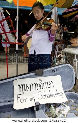 BANGKOK - JULY 19: Student begs for education on chatuchak weekend market July 19 in Bangkok, Thailand